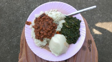 Usually you would eat wali na maharage (rice and beans) or bugali with some type of greens, but Mama Julienne gave me both on this day because she knew my love for bugali. I have a small amount of pilipili (habanero pepper paste) in the center of my plate as well. PC: KSB