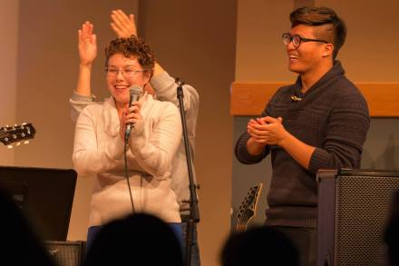 Leading worship at a multicultural worship night. PC: Wheaton College Student Activities Office