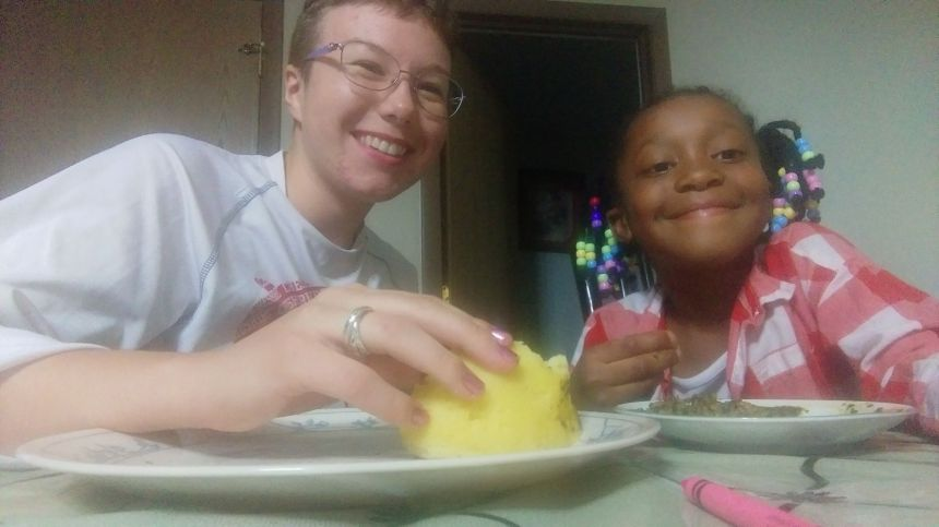 Hanging out with my young friend, eating ugali and sombe. PC: KSB